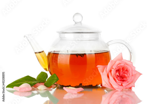 teapot of tea with rose isolated on white
