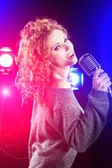 Beautiful brunette woman singing