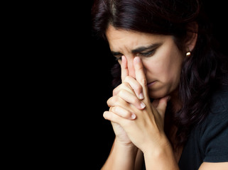 Stressed  woman with a thoughtful sad look isolated on white