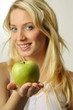 Sexy blond girl with apple