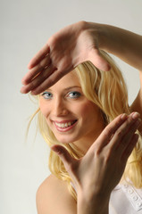 Young woman pretending picture frame with her fingers