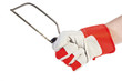 Hand with protection glove holding Hacksaw