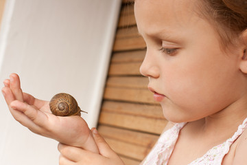 child with a snail