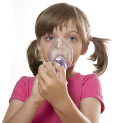 ill little girl using inhaler