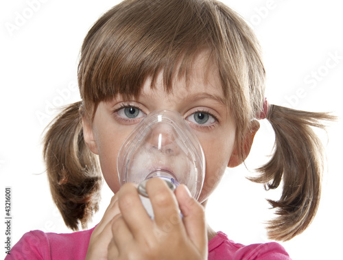 little girl using inhaler - respiratory problems