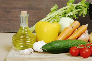 Various vegetables and olive oil on desk