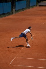 tennis player at the service