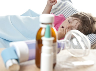 little girl sleaping in the bed and drugs, inhaler