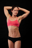 Muscular woman on black background