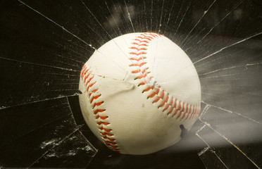 Baseball through broken glass window.