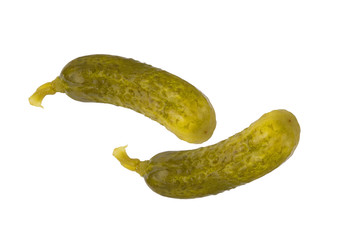 two fresh dill pickles on a white background