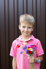Сhild with a bouquet of wild flowers