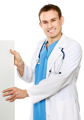 A male doctor with a blank billboard.