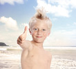 Blonde Boy Giving Thumbs Up at the Beach