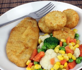 Breaded and crumbed vegetarian dish with mixed vegetables