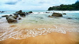 Sea surf in a tranquil tropical bay. Thailand, Phuket.