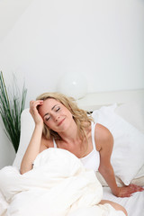 Woman dreaming in bed
