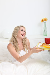 Woman receiving breakfast in bed