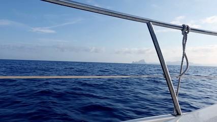 boat sailing in blue mediterranean sea on ibiza islands