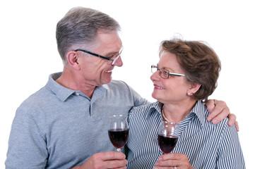Senioren mit Weinglas in der Hand