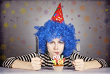 Funny blue-hair girl with cake.