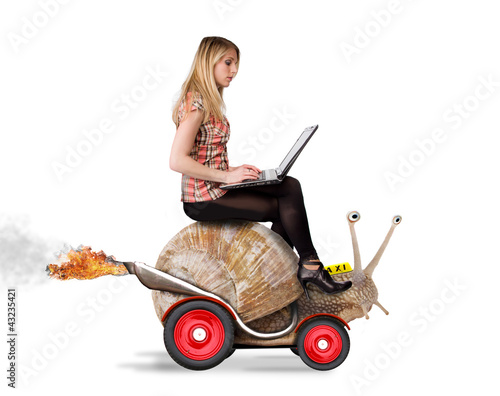 Attractive blond girl with laptop riding on speedy snail