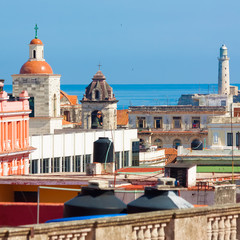 The roofs of Old Havana with El Morro in the background