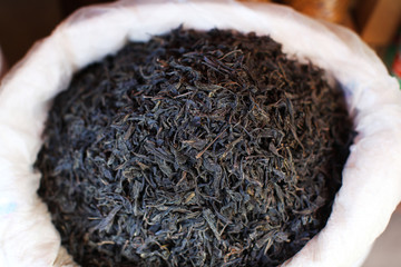 Black tea dried leaves selling in a bag on the market in India