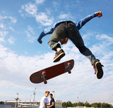 Skater jumps high in air - 43237453