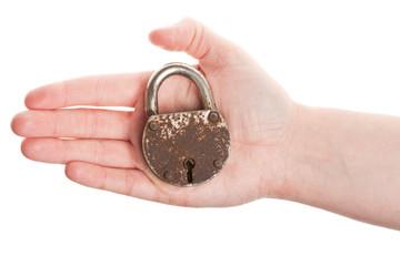 Hand holding old padlock