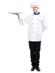 Full length chef holding a plate