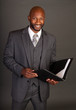 Young Black Business Man with a portfolio