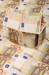 Small house made with fifty euro bank notes