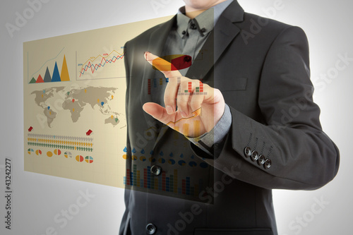 Business man pressing high tech type of modern graph on a virtua