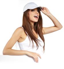 Sexy girl holding a blank billboard.