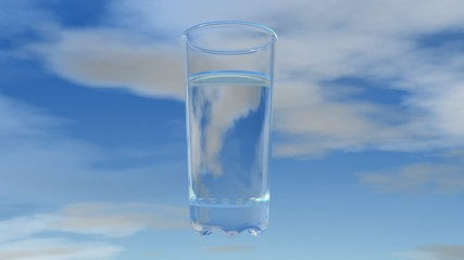 Glass of water with sky background.