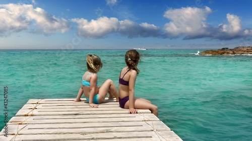 little sisters girls looking idyllic beach landscape