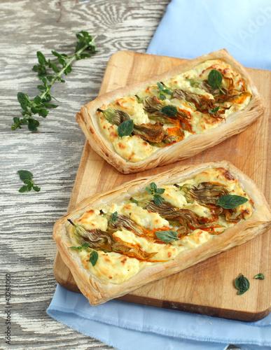 Zucchini flower and ricotta tart