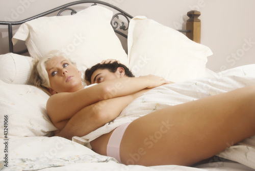 Young lovers in bed