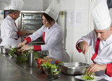group of young beautiful professional chefs portrait in industri