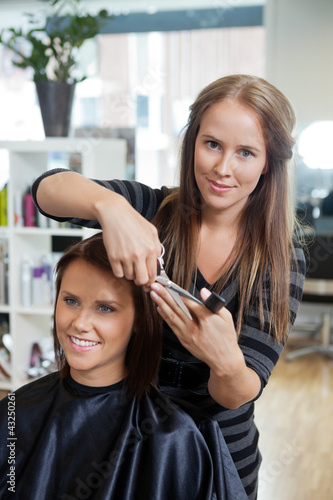 Stylist Giving a Haircut To Woman