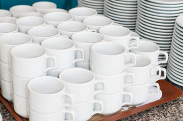 Catering. saucers, and cups of tea.