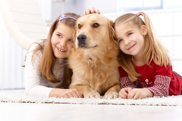 Cute little girls with pet dog smiling