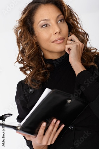 Portrait of busy businesswoman