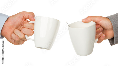 Business partners hands holding cups of coffee