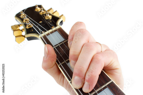 Playing electric guitar closeup, isolated on white
