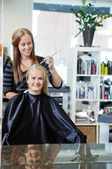 Woman Getting Hair Highlighted