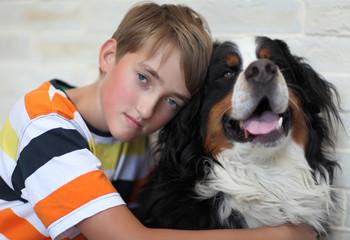 Sad  boy with a dog