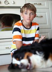 Boy and dog. Focus on  boy