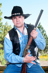 A cowboy holding his rifle